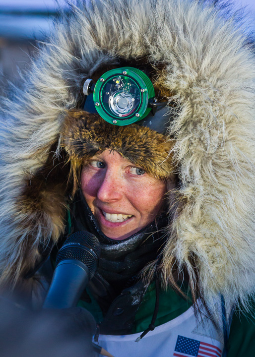 Paige at the finish line of the Iditarod in 2013 sporting her Scurion. Photo by Scott Chesney